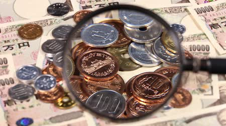 magnifier : Japanese yen bill and magnifying glass and coins