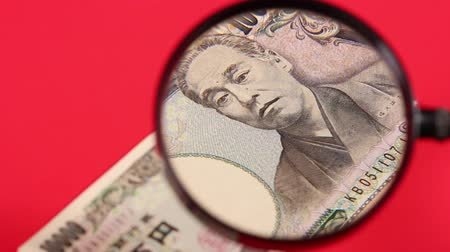 appraisal : Japanese yen bill and magnifying glass