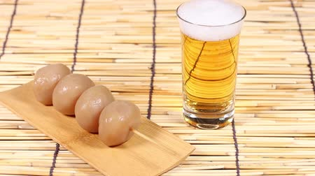 bamboo curtain : Japanese food simmered konjac and glass of beer