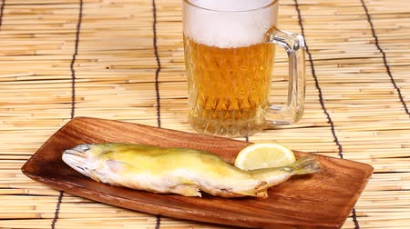 bamboo curtain : Grilled sweetfish and mug of beer
