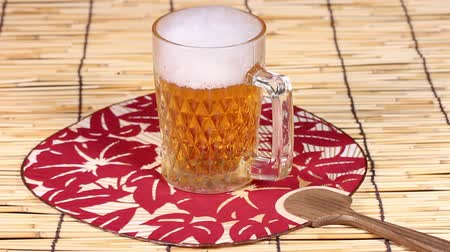 bamboo curtain : Mug of beer and japanese fan