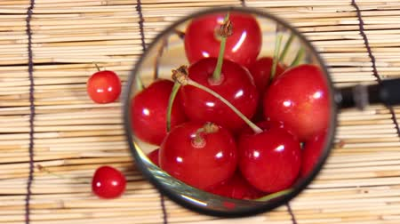 bamboo curtain : Sweet ripe cherry and magnifying glass