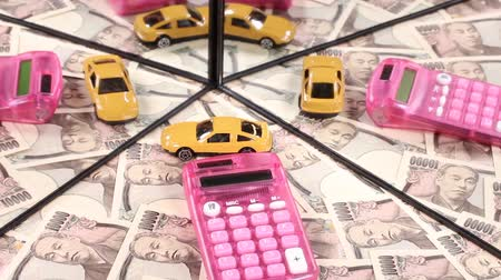 expenditure : Ten thousand yen bill and calculator and mini car reflecting in the mirror Stock Footage