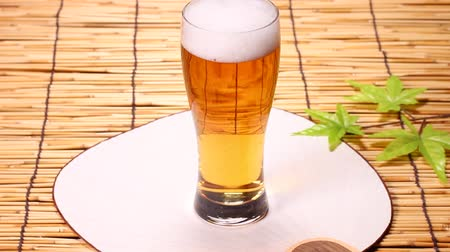 bamboo curtain : A glass of beer and japanese fan