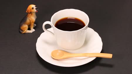 copinho : A cup of coffee and dog ornament