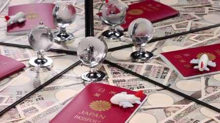 miniatűr : Travel image; Japanese passport and 10000 yen bills reflecting in the mirror