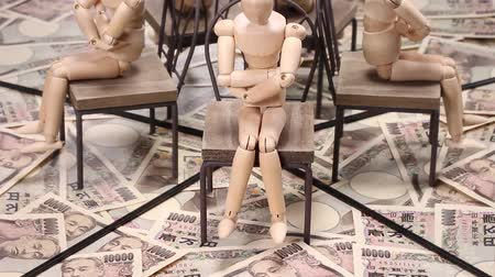 заем : 10000 Yen bills and wooden doll reflecting in the mirror