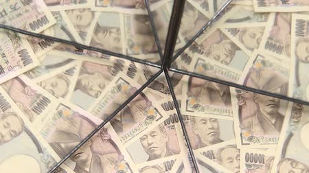 custo : 10000 Yen bills reflecting in the mirror