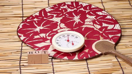 bamboo curtain : Thermometer and japanese fan