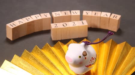 ventaglio : New year images Gold fan and Ox Figurine Filmati Stock