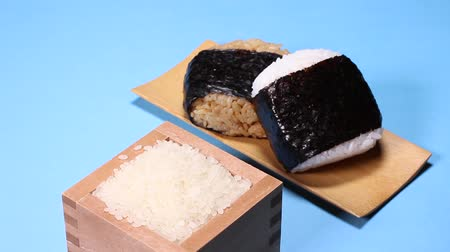 нори : Rice balls and wooden cup of Rice