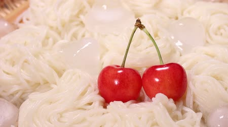 bamboo basket : Japanese food Somen noodles with Cherries Stock Footage