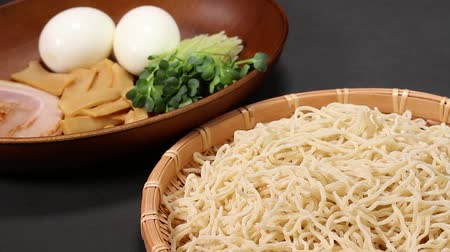 bamboo basket : Ingredients of Ramen noodles on black background