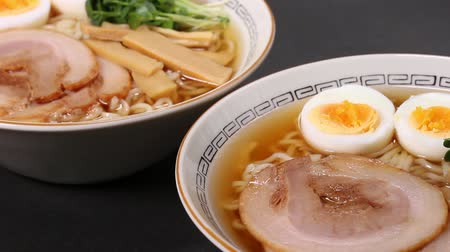 ramen : Ramen noodles in soy sauce flavored soup. Stock Footage