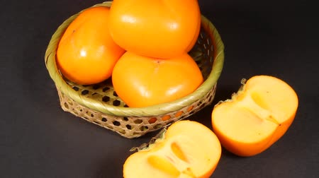 bamboo basket : Shonai Persimmon which is autumn fruit of Japan