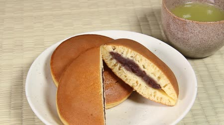 lanches : Japanese sweets Dorayaki and  Tea Stock Footage
