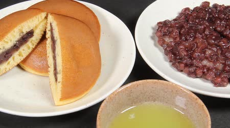 equinox : Japanese food Botamochi and dorayaki and tea Stock Footage