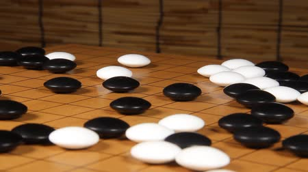 bamboo curtain : Rotating go board and go stone. Go is Chinese board game