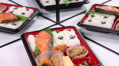 refletindo : Bento Box of grilled salmon reflecting in the mirror Stock Footage