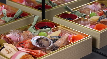 crab eating : Japanese New Year dishes Osechi reflected in the mirror.letter meaning congratulations Stock Footage