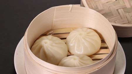 bamboo basket : Steamed pork dumplings in steaming basket Stock Footage