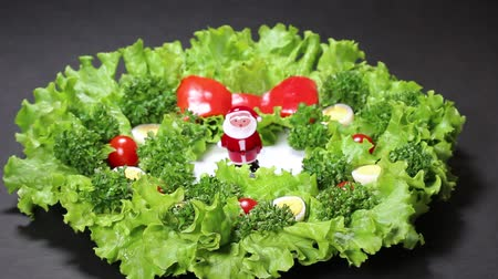 hard boiled : Vegetable Christmas Wreath and Santa Claus Doll Stock Footage