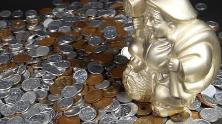 there : A lot of Japanese coins and Daikoku god.  Character Meaning Fortune