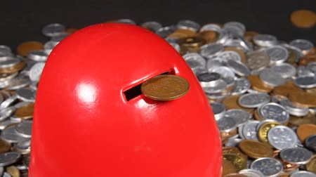 allowance : Lots of Japanese coins and Daruma piggy bank Stock Footage