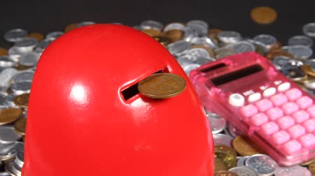 piggy bank : Lots of Japanese coins and Daruma piggy bank and  Calculator Stock Footage