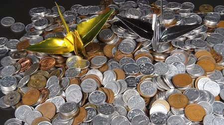 there : A lot of Japanese coins and  paper crane of gold and silver Stock Footage