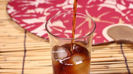 bamboo curtain : Iced coffee pouring down into a glass