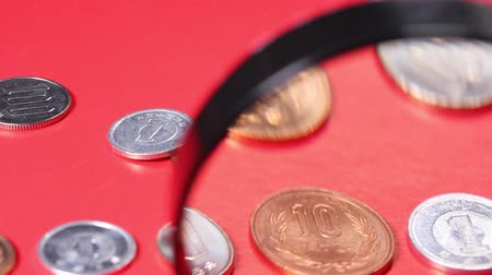 magnifier : Japanese coins and magnifying glass Stock Footage