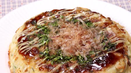 mayonaise : Japanese food  Okonomiyaki close up rotating