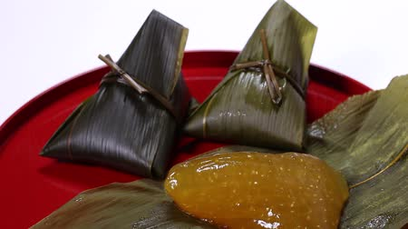 rice cake : Sasamaki, Japanese traditional cuisine made of rice and wrapped bamboo leaves. Stock Footage