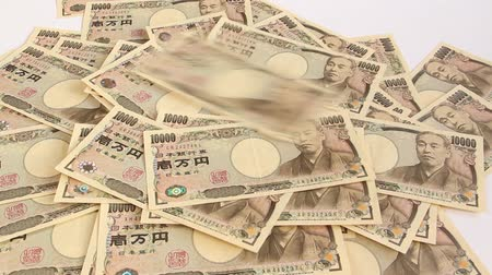 10000 yen bills that falling Stock Footage