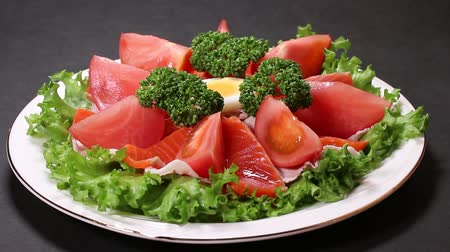 parsley : Salmon Salad Close up on black background Stock Footage
