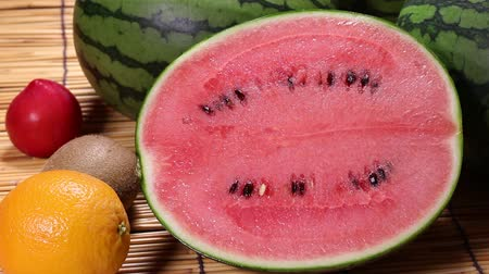 mais : Small  Watermelon and Fruit rotating Stock Footage