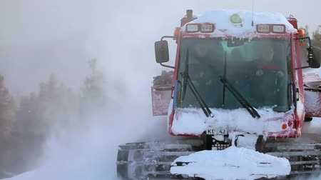 snowcat : Red crawler ratrack near ski-route in mountains. Stock Footage