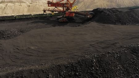 bagger : A large bucket wheel excavator digging brown-coal in an open-pit mine Stock Footage