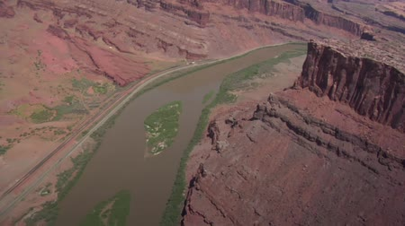 sál : aerial shot of red rock cliffs and Colorado River