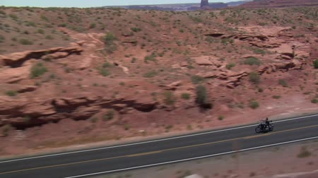 ад : aerial shot of three motorcycles on Monument Valley Highway