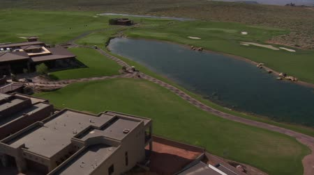 irrigate : Aerial shot of lake on desert golf course