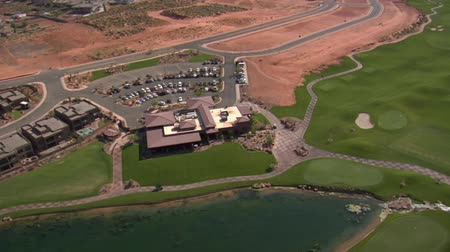 clubhouse : Aerial shot of clubhouse on desert course with lake