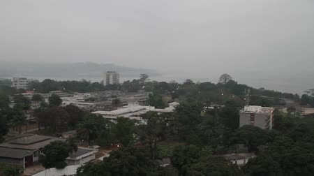 demokratický : buildings and Congo River with smoke in Kinshasa