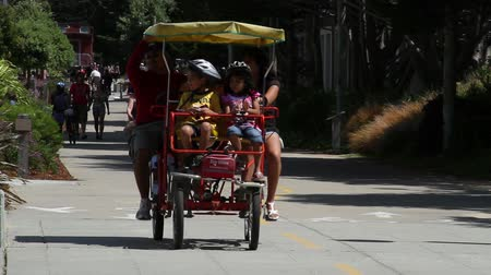 rowerek : family pedals car on  bicycle path