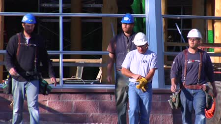 montáž : construction workers walked toward camera slow mo