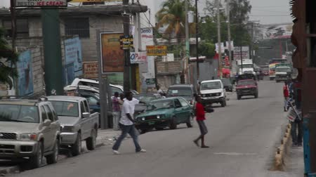 homeless : people walk across street in Haiti