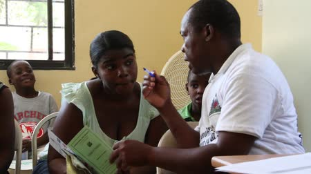 homeless : doctor instructs woman in the Haitian clinic