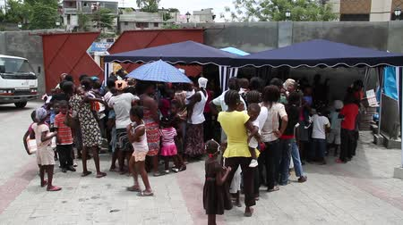 homeless : lines of people at vaccination clinic in Port-au-Prince Haiti
