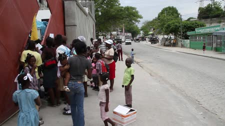homeless : lines of people on sidewalk at vaccination clinic
